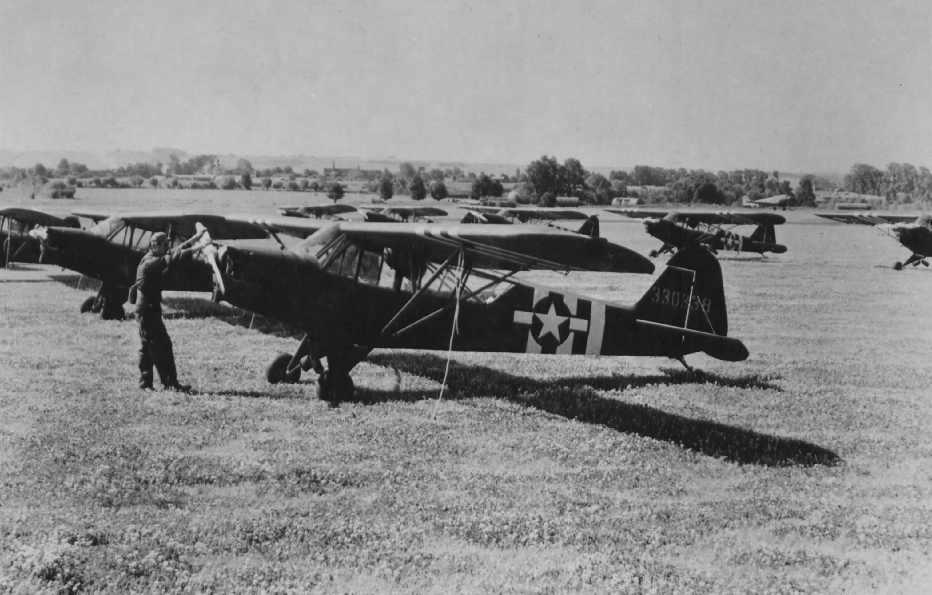 L Birds in 1944, in Normandy - gathering Piper L-4 and L-5 Stinson