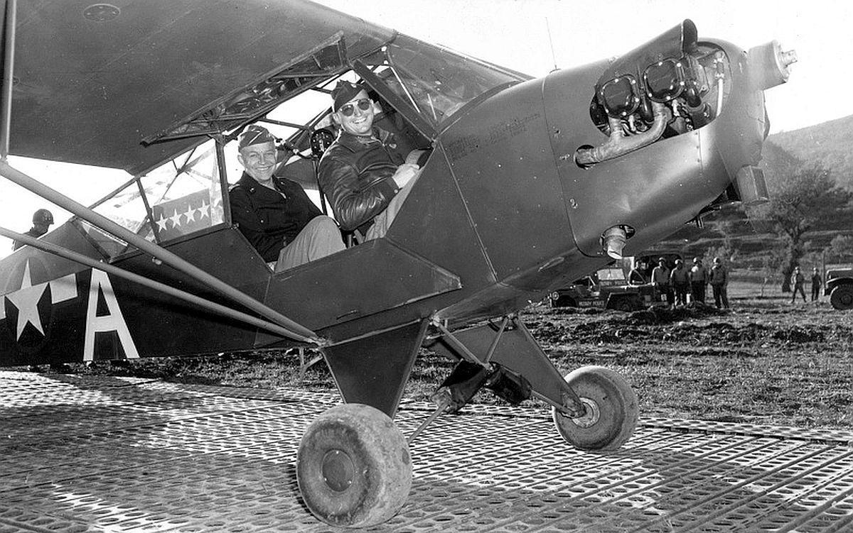 General Eisenhower aboard a Piper L - 4