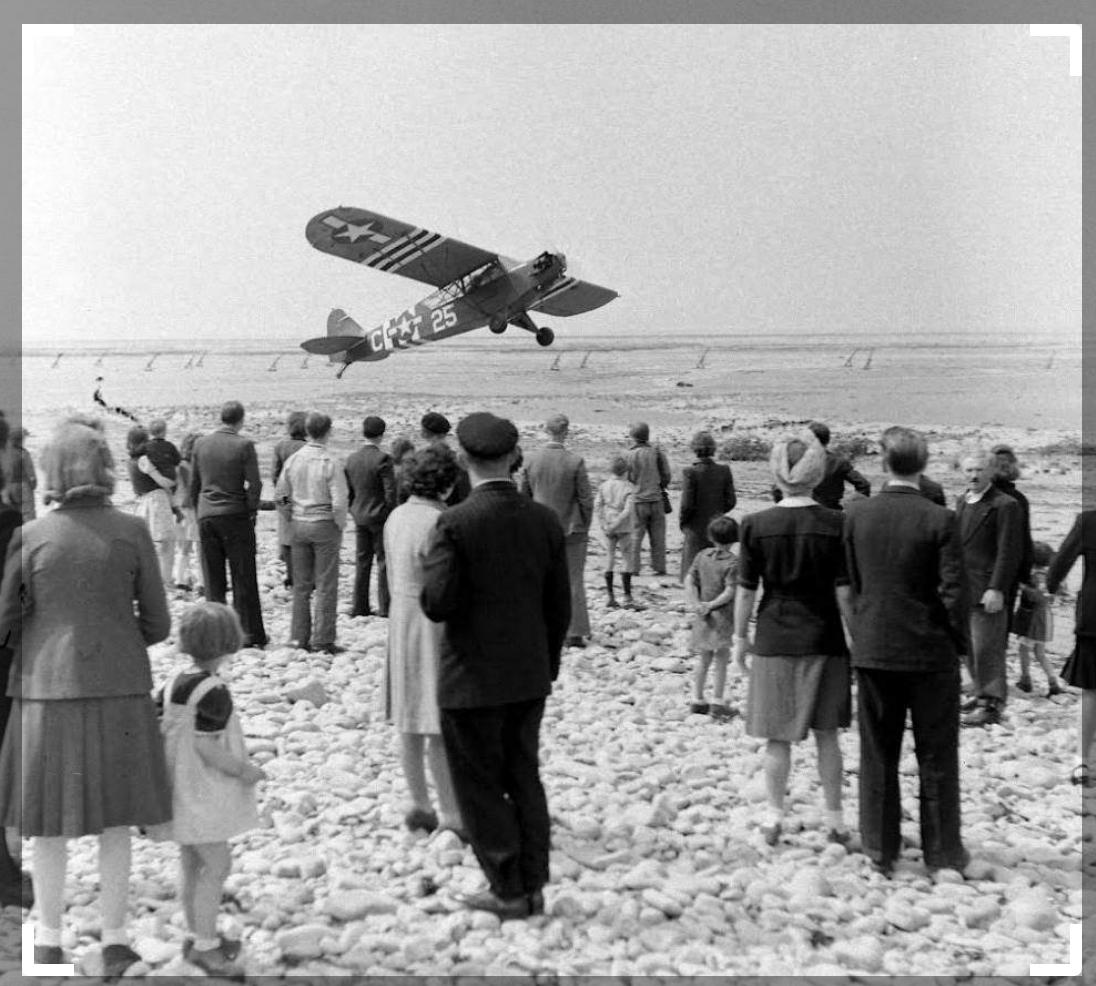 Grand-Camp takeoff of a Piper L - 4